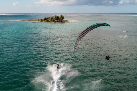 when a paramotor races a jet ski !!